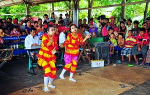 The locals turn out to see the dancing girls and the strange white people when we arrive at Naba